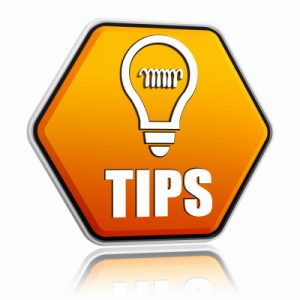 tips and bulb symbol in orange hexagon banner